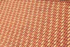 Rooftiles. Laid uniformly with regular patterns of yellow and orange colored tiles Royalty Free Stock Images