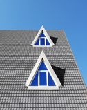 Rooftop. Modern tiled rooftop against blue sky Royalty Free Stock Photo