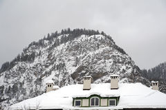 Rooftop. Mountaintop with a rooftop covered with snow in foreground Royalty Free Stock Photography
