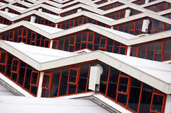 Rooftop. Long repetition of windows on a building rooftop stock images