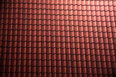 Rooftop. Red rooftop pattern lit from the upper right corner Stock Image