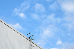 Rooftop access ladder. Outside escape or access ladder on the side of a building Stock Photo
