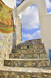 Rooftop arcades and stairs covered with mosaic. Tiles. Tunisia. Tunis - old town (medina) seen from roof top. Ornamental arches and wall covered tiles with Stock Photos