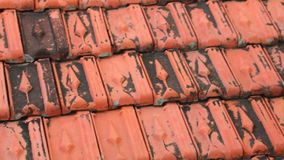 Rooftop Baked Clay Tiles Old And Weathered Stock Footage. Red rooftop baked clay tiles old and weathered panning camera high definition stock footage clip stock video