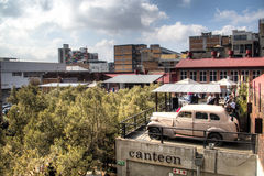 Rooftop bar with old car in Arts on Main, Maboneng. JOHANNESBURG, SOUTH AFRICA – CIRCA JULY 2015: Rooftop bar Canteen with old car in Arts on Main, Maboneng Royalty Free Stock Images