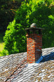 Rooftop chimney. An old traditional chimney constructed of bricks on a traditional Norwegian house Royalty Free Stock Image