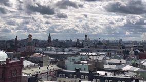 Rooftop city-view of Moscow from the view point on top of Detskiy Mir trading center. Rooftop view on Moscow Kremlin and many Orthodox churches and cathedrals stock video