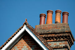 Rooftop on clear blue sky. Old english roof top with chimneys royalty free stock photo
