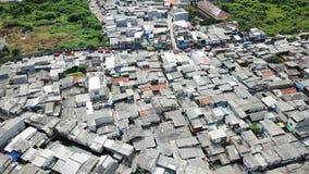 Rooftop of crowded slum neighborhood. Aerial landscape of rooftop of crowded slum neighborhood on lakeside at North Jakarta, Indonesia Royalty Free Stock Photo