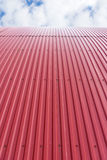 Rooftop of curved red corrugated iron Stock Photos