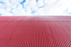 Rooftop of curved red corrugated iron Royalty Free Stock Image