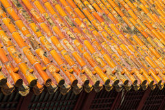 Rooftop with decorative dragon tiles Stock Photo