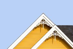 Rooftop detail with decorative fretwork. Detail of the gingerbread style fretwork of the typical wooden houses of Iles de la Madeleine, or the Magdalen Islands Royalty Free Stock Photography