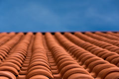 Rooftop. Detail of roof covered in orange tiles Stock Photos