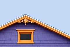 Rooftop detail window and decorative fretwork. Detail of the gingerbread style fretwork of the typical wooden houses of Iles de la Madeleine, or the Magdalen Stock Photo