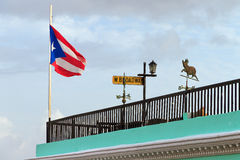 Rooftop flag San Juan. Puerto Rican flag on top of a roof in San Juan, Puerto Rico royalty free stock photos