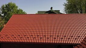 Rooftop of the house is covered with stylish and durable red color lightweight metal roofing sheets or roof panels