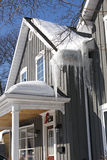Rooftop with Ice and Snow. A build up of ice and snow on the roof of a Victorian home in Canada presents a challenge for the homeowner stock photo