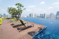 Rooftop Infinity Pool - Bangkok, Thailand. Modern rooftop infinity pool on 40th floor of condo building in Bangkok, Thailand Royalty Free Stock Photography