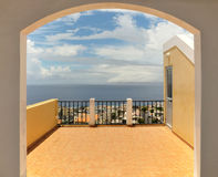 Rooftop lving. An arched doorway leads to a rooftop deck overlooking the sea front city of Sao Filipe, Cabo Verde Royalty Free Stock Images