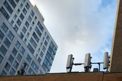 NYC urban rooftop mobile cell towers Stock Image