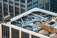 Rooftop of a modern skyscraper office building Stock Photos