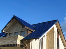 Rooftop of a new house. With blue pantiles Stock Photos