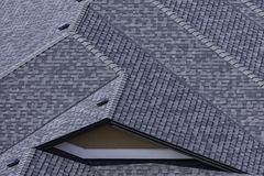 Rooftop in a newly constructed subdivision in Kelowna British Columbia Canada showing asphalt shingles. And multiple roof lines royalty free stock images