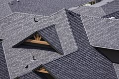 Rooftop in a newly constructed subdivision in Kelowna British Columbia Canada showing asphalt shingles. And multiple roof lines Stock Photo