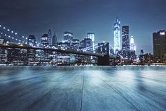 Rooftop with night city background. Concrete rooftop with beautiful night city view background stock image