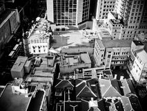 Rooftop overview cityscape of Sydney. Cityscape overview of sydney in black and white stock photo