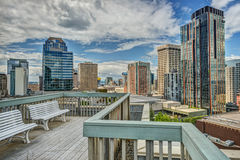 Rooftop Patio in downtown Seattle, WA. Rooftop patio with benches offer view of downtown Seattle skyscrapers Royalty Free Stock Photography