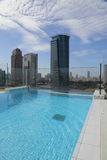 A rooftop pool with city views Royalty Free Stock Images