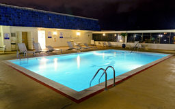 Rooftop pool at night Stock Photography