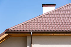 Rooftop with a rainwater drain Royalty Free Stock Image
