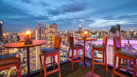 Rooftop Restaurant. BANGKOK, THAILAND - June 3: View from the top of Above Eleven rooftop bar & restaurant on June 3, 2015 in Bangkok, Thailand. Above Eleven is Royalty Free Stock Images