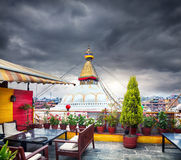 Rooftop restaurant and Bodnath stupa Royalty Free Stock Photos