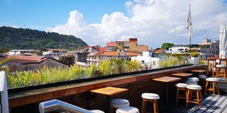 Rooftop restaurant in old city royalty free stock photography