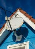 Rooftop satellite antenna Royalty Free Stock Image