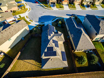 RoofTop Solar Panels Aerial Above Suburban Home Providing Clean Sustainable Green Energy Royalty Free Stock Images