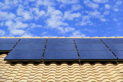 Rooftop Solar Panels on a Southwestern Style House. Photovoltaic Solar Panels on the Roof of a Residential Southwestern Style House Royalty Free Stock Photo