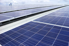 Rooftop Solar PV System. With technicians stock photo