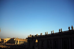 Rooftop statues. Tall statues along the edge of the roof of a large building royalty free stock photos