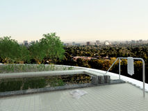 Rooftop swiming pool with cityscape view Royalty Free Stock Photo