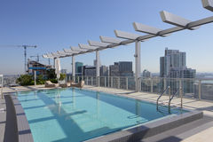 Rooftop swimming pool in the city Stock Photos