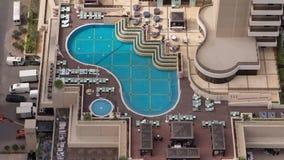 Rooftop swimming Pool in Dubai Marina aerial timelapse. Rooftop swimming Pool with blue water in Dubai Marina aerial timelapse. Chairs and umbrellas around, bar stock video footage