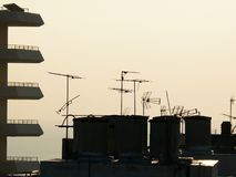 Rooftop television antennas stock photography