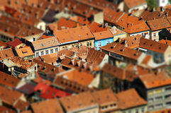 Rooftop tilt shift view of a European city. Brasov, Romania Royalty Free Stock Image