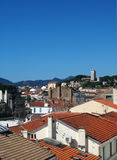 Rooftop view Cannes France old town fort in background. Rooftop view of Cannes France French Riviera old town fort in background Stock Images