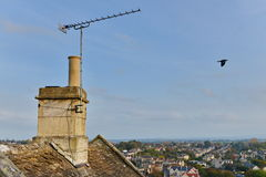 Rooftop View. View from the Rooftop and Chimney of an Old Cottage with a Cityscape in the Background Royalty Free Stock Images